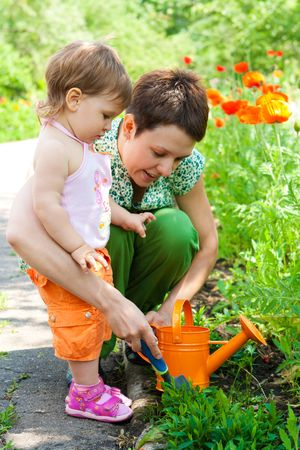 Woman and little girl doing gardening photo