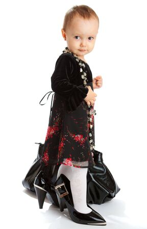 Young fashion lady in mothers shoes photo