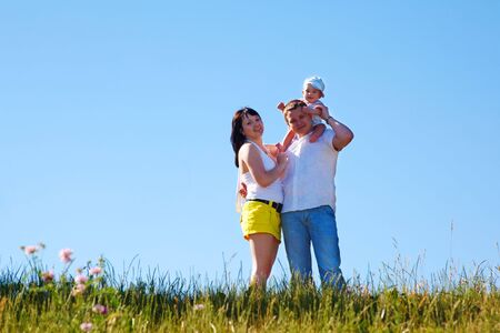 Happy smiling family standing on the hill Stock Photo - 5106475