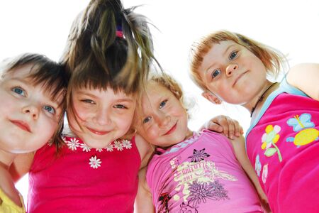 Portrait of  the four happy friends hugging Stock Photo - 5106426