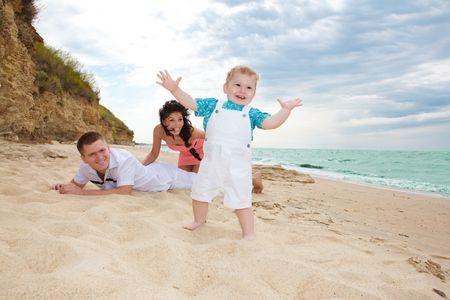 Lovely family having fun on the beach photo