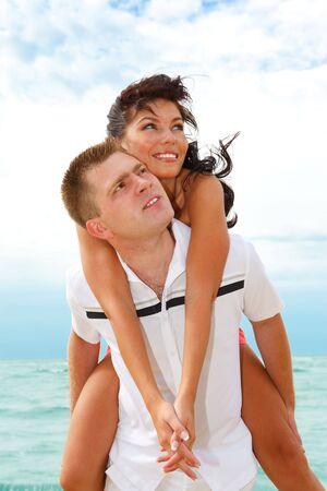 Beautiful happy couple on the summer beach  photo