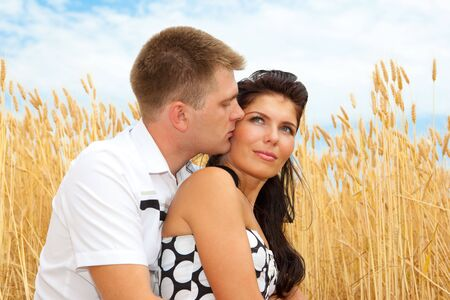 Couple enjoying their time together in the wheat field photo