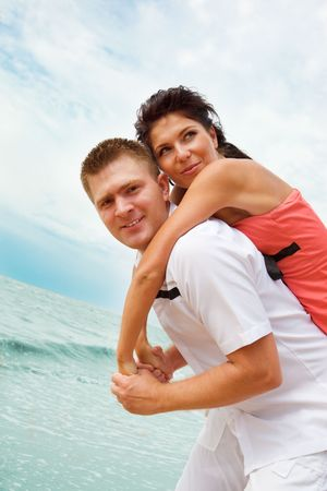 Young man and woman playing on the beach Stock Photo - 5111984