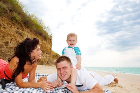 Mother, father and baby boy enjoying their weekend on the beach Stock Photo - 5134043