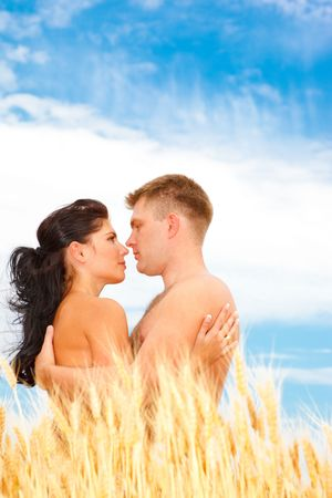 A beautiful couple standing in wheat field Stock Photo - 5134041