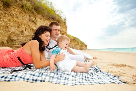 A cheerful family playing on the beach Stock Photo - 5147463
