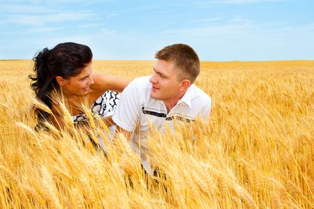 A man and woman playing in the wheat field Stock Photo - 5147467