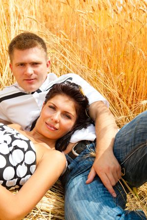 A couple having rest in the wheat field Stock Photo - 5147468