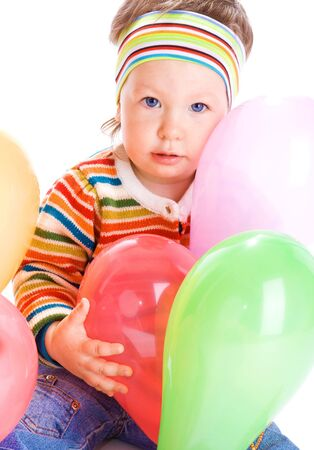 Girl sitting with many colorful balloons, isolated photo
