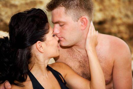 Portrait of a romantic couple in the rocks photo