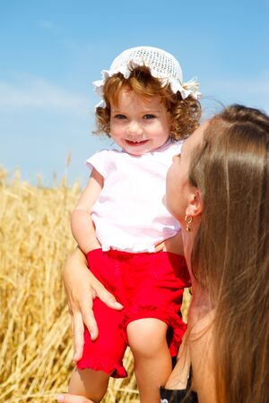 Toddler having fun with mother in a wheat field Stock Photo - 5210832