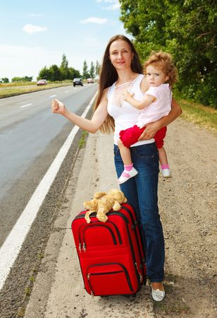 Mum and daughter on the road, hitchhiking Stock Photo - 5210961