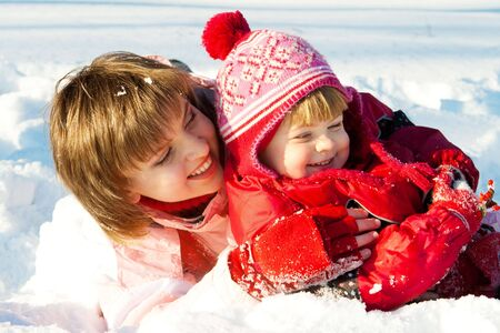 Mother and daughter playing in the snow Stock Photo - 5247541