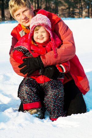 Dad and his daughter having fun in winter park Stock Photo - 5247528
