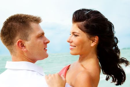 Portrait of a loving couple on the coastline photo