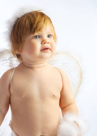 baby angel: Portrait of a red-haired baby angel Stock Photo