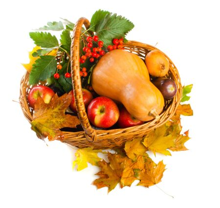 Basket with autumnal fruit and vegetables, shot from top photo