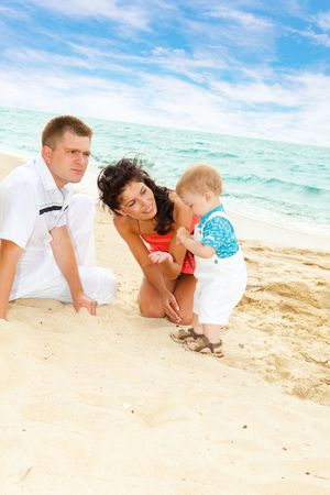 Lovely family playing in the sand photo