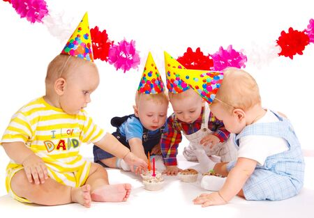 first birthday: Four lovely toddlers at the birthday party Stock Photo