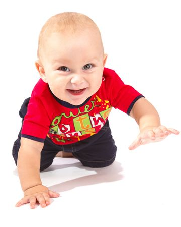 baby crawling: Sweet baby boy crawling, isolated Stock Photo