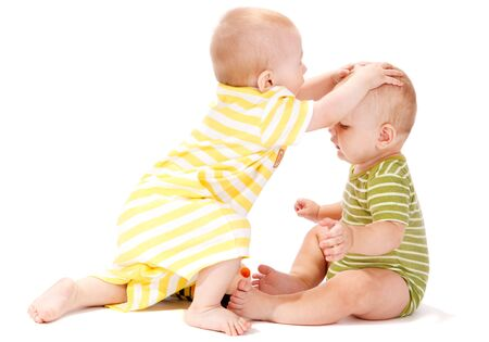 Two baby boys playing together, isolated, over white Stock Photo - 5362034