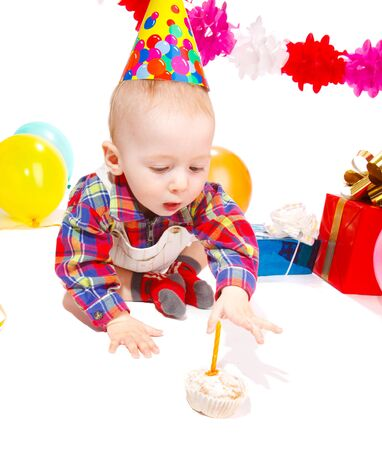Baby boy celebrating his first birthday, isolated photo