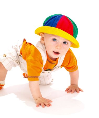 Baby boy in a funny hat, crawling photo