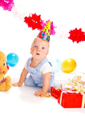 Astonished baby boy at the birthday party Stock Photo - 5411313