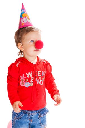 Toddler with a funny nose and birthday hat on photo