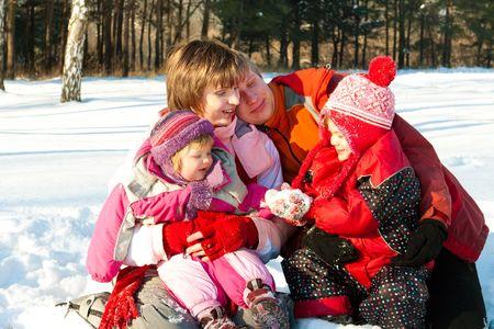 Family having fun in the winter park Stock Photo - 5427888