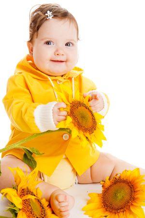 Cheerful baby girl sitting among sunflowers Stock Photo - 5427886