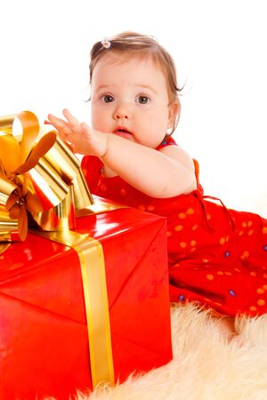 Cute baby girl and a large present box Stock Photo - 5427894