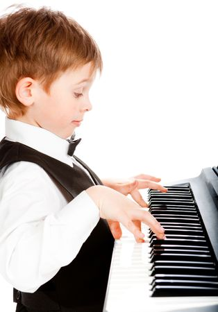 making music: Little pianist making his first steps in music