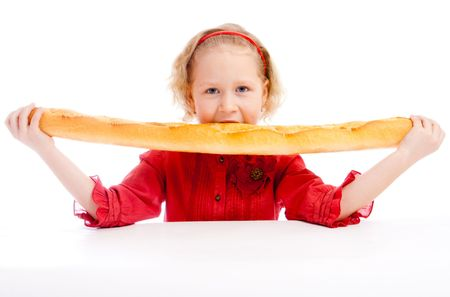 Preschool girl biting a French bread Stock Photo - 5484152