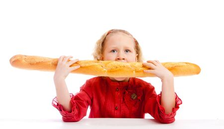 Cute blond girl eating a French bread Stock Photo - 5484151