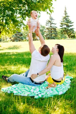 Young family in park at the weekend photo