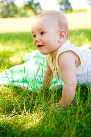 Cute smiling  baby in the summer park photo