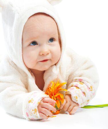 Baby holding orange flower, isolated Stock Photo - 5526887
