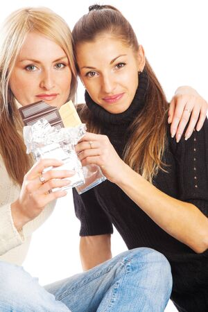 Two lovely friends holding chocolate bars photo