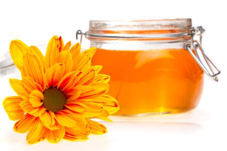 honey pot: Honey in a jar and flower beside it