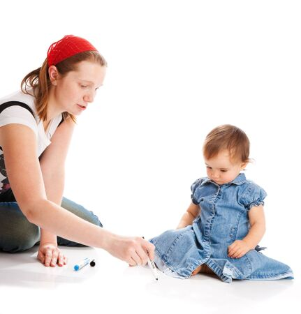 Mother teaching her daughter to write photo