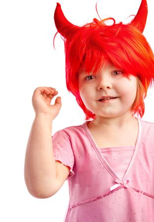 Cute little girl in a red wig with horns, isolated photo