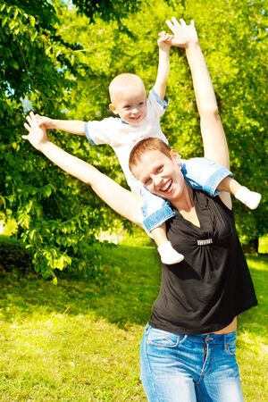 Mother and son having fun outdoors photo