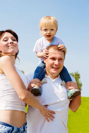 Young happy family in the outdoor photo