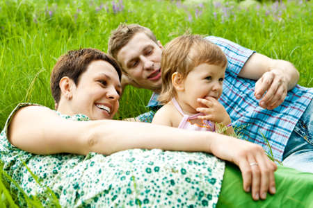 Happy family on a summer meadow Stock Photo - 5670746