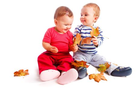 Happy toddlers playing with autumn leaves Stock Photo - 5670790