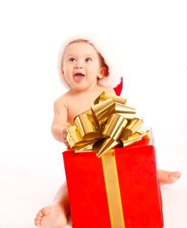 Baby boy sitting with Christmas present Stock Photo - 5670764