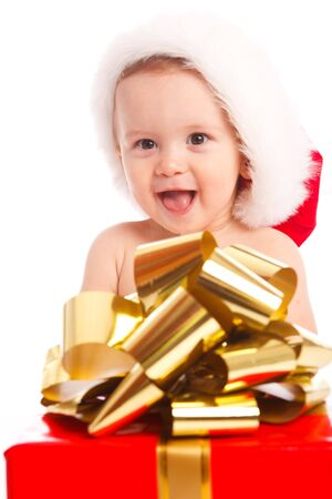 Portrait of a baby with Christmas present photo