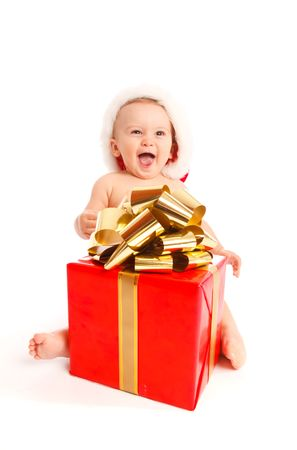 Baby boy sitting with Christmas present Stock Photo - 5670771